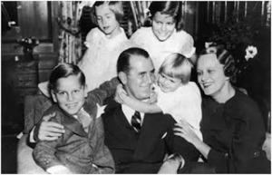 Grace con sus padres y hermanos